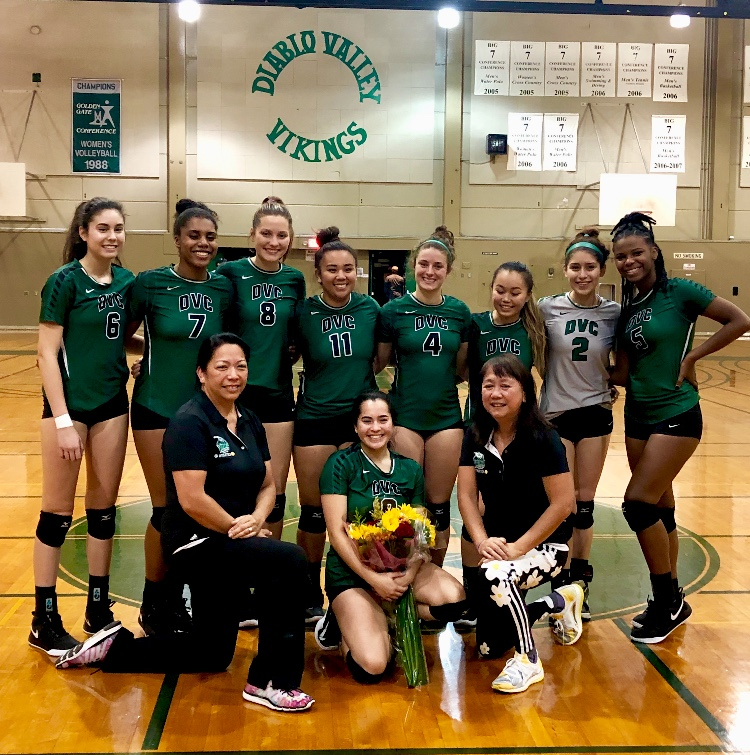 DVC Volleyball team poses around their setter, Tida Twitchen on her sophomore night on Wednesday, Nov.7, 2018. (Isabel Villalobos/The Inquirer)