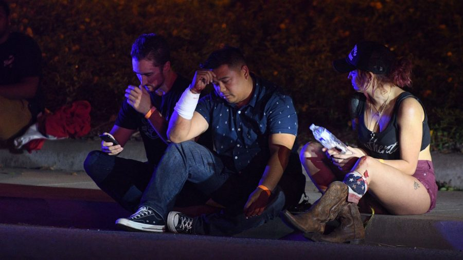 Fernan Diamse, center, cut his arm while breaking a window to escape the shooting Wednesday at the Borderline Bar and Grill in Thousand Oaks. (Photo courtesy of Mike Baker / For The Times)