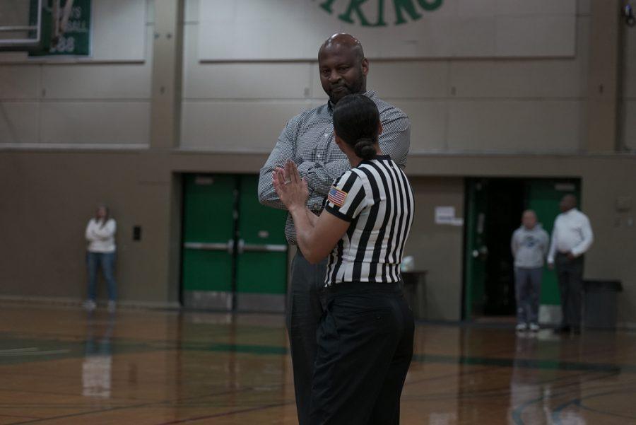DVC Womens Basketball head coach Ramaundo Vaughn talks with a referee during the teams match against Sacramento City at DVC's gymnasium on January 8th, 2019.