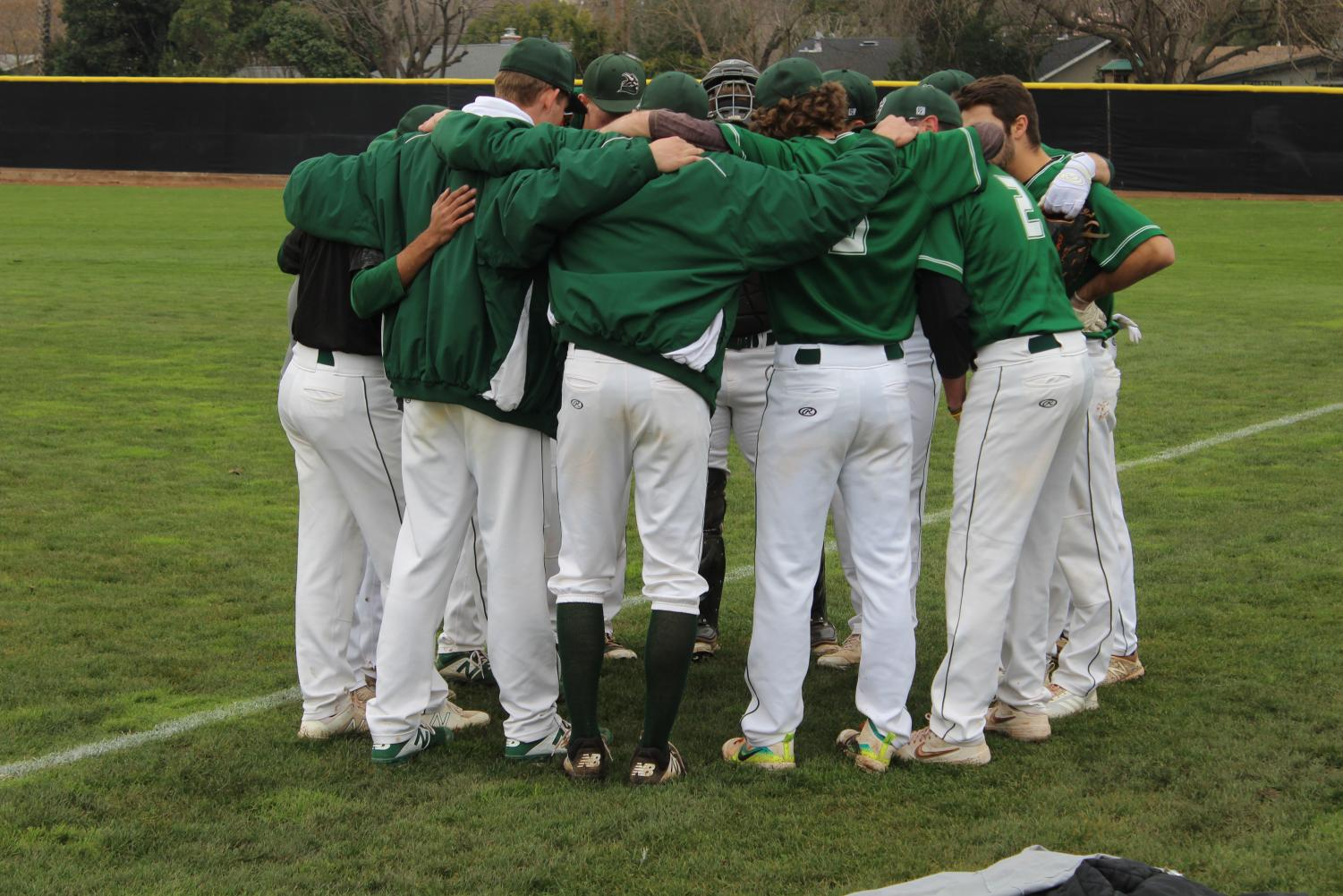All of the baseball players huddle before the game.(Alex Martin/The Inquirer).