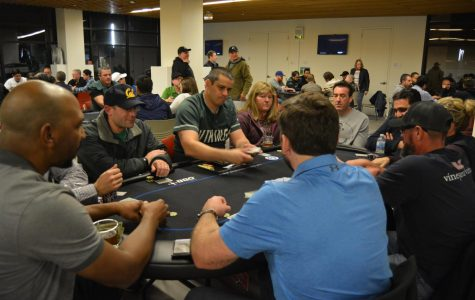 Jason Burke (Blue Dog Dealer) starts next round of poker at DVC Poker Night. (Samantha Laurey/The Inquirer).