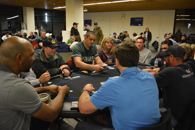 Jason Burke (Blue Dog Dealer) starts next round of poker at DVC Poker Night. (Samantha Laurey/The Inquirer).