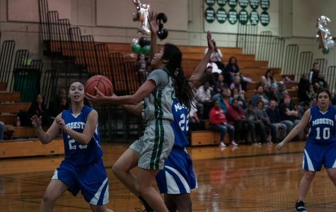 Freshman guard Jasmine Kong (center) scores a layup during the Viking's sophomore night game against Modesto.