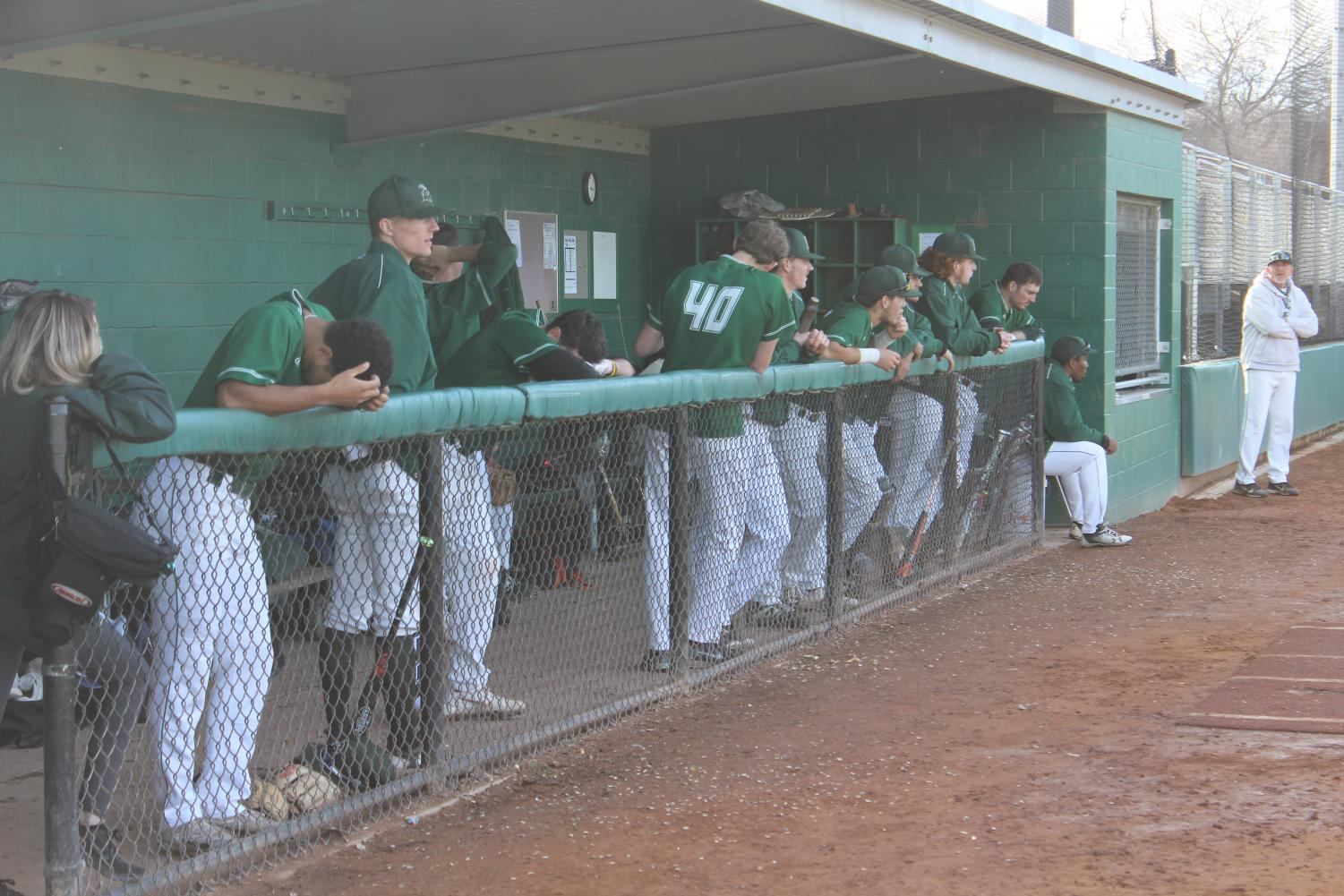 The Vikings watch the home game from their dugout in the matchup against Cabrillo on Tuesday, Feb. 20. The Vikings lost 9-7. (Alex Martin/The Inquirer).