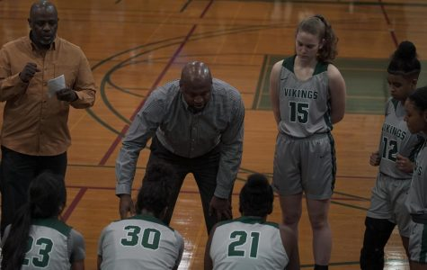 Head coach Ramaundo Vaughn (center) and assistant coach Kameo Williams (left) talk with players in a timeout during the match against Sacramento City at DVC on January 8th, 2019. (Ethan Anderson/Inquirer)