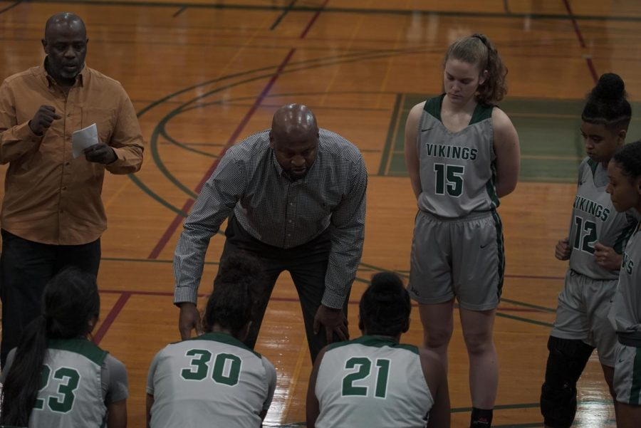 Head+coach+Ramaundo+Vaughn+%28center%29+and+assistant+coach+Kameo+Williams+%28left%29+talk+with+players+in+a+timeout+during+the+match+against+Sacramento+City+at+DVC+on+January+8th%2C+2019.+%28Ethan+Anderson%2FInquirer%29