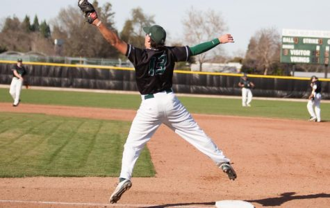 First baseman Leo Costa jumps to catch the ball at DVC's game against Mission College on Feb. 12, 2015. The Vikings won 4-3.
