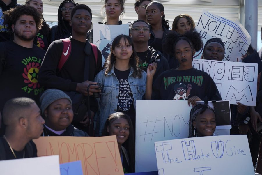 Students of color and others gathered yesterday during a walkout, to voice the lack of communication from president Susan Lamb--regarding racial slurs and a lynching illustration, found in the Engineering and Technology building.  From left to right starting at the top: Brenda Ortiz, Ohemaa Asare, Halea Monigan, Tre Stone, Sadé Creel. 2nd row: Juwan Roquemore, Sam, Vanessa Galang, Bishari Taylor, Kiana Stewart, Haley Hall. 3rd row, at the bottom: Lee West, Daechelle Harper, J'Dah Christian and Sam Kanyika (Ethan Anderson/The Inquirer)