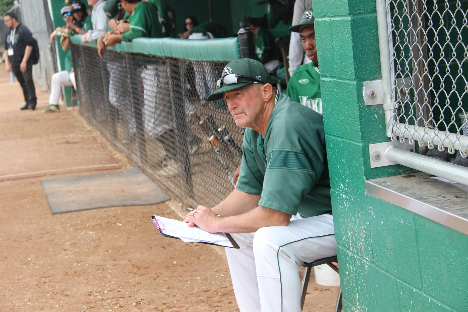 Coach Steve Ward watches the baseball team's match up against the Modesto Pirates from their dugout on March 19, 2019. Vikings lost 7-1. (Alex Martin/The Inquirer)