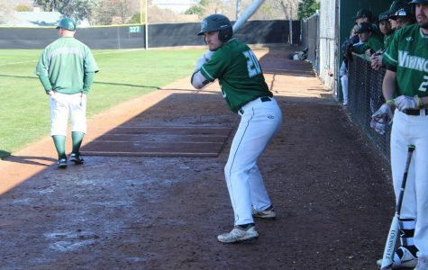 First basemen Dante Peretti taking swings in the on deck circle in the game against Cabrillo on Feb. 19, 2019. The Vikings lost 9-7. (Alex Martin/The Inquirer)