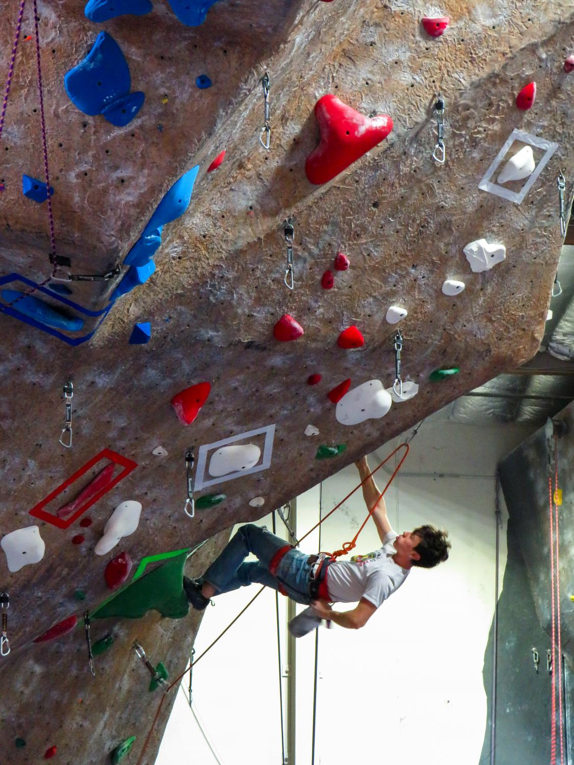 A Touchstone Climbing Series competitor chalks up before his next big move. (Pavlina MarkovaThe Inquirer).