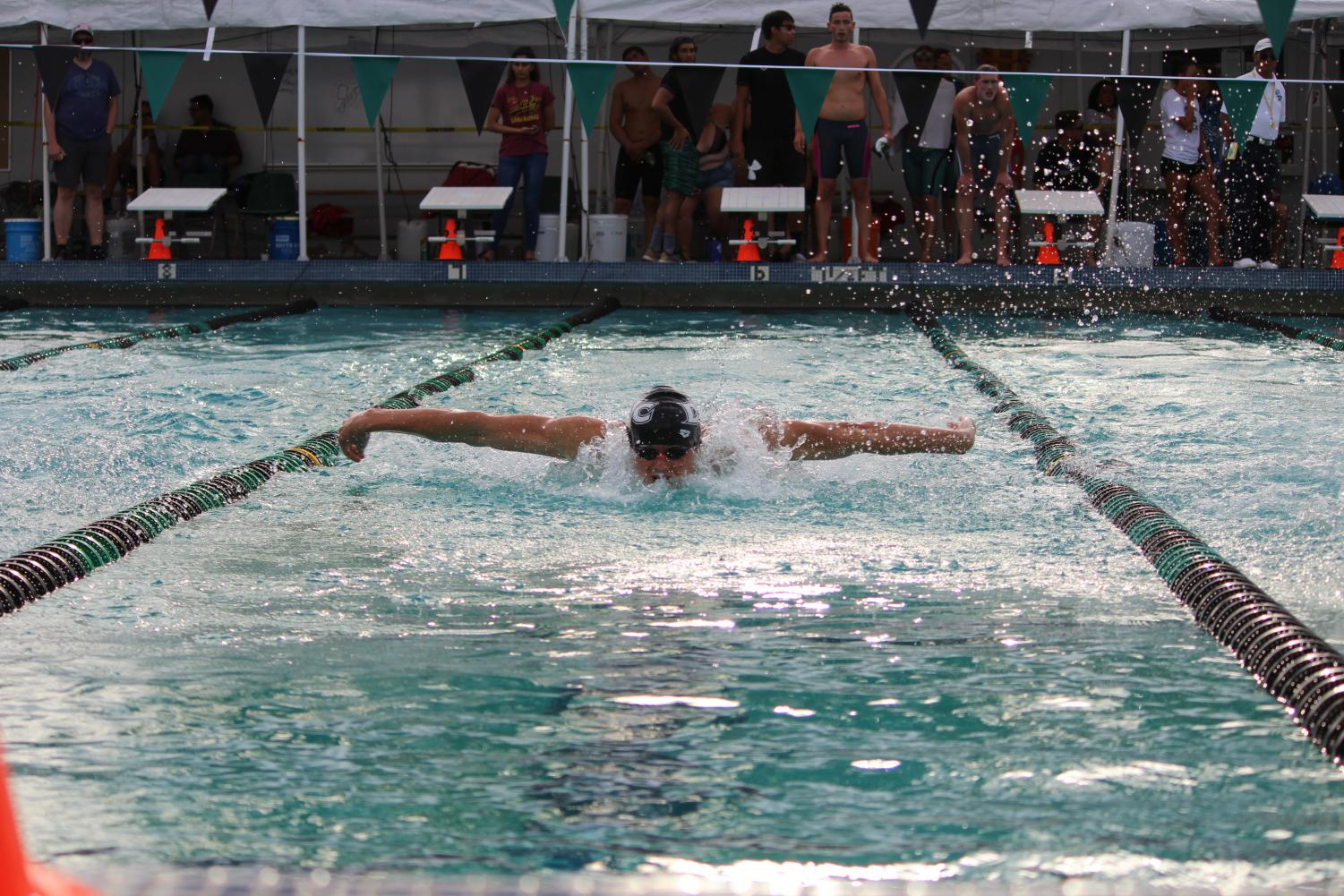 A DVC swimmer races in breaststroke during the Big 8 Championships at DVC, which took place from April 18 through April 20. (Samantha Laurey, Inquirer)