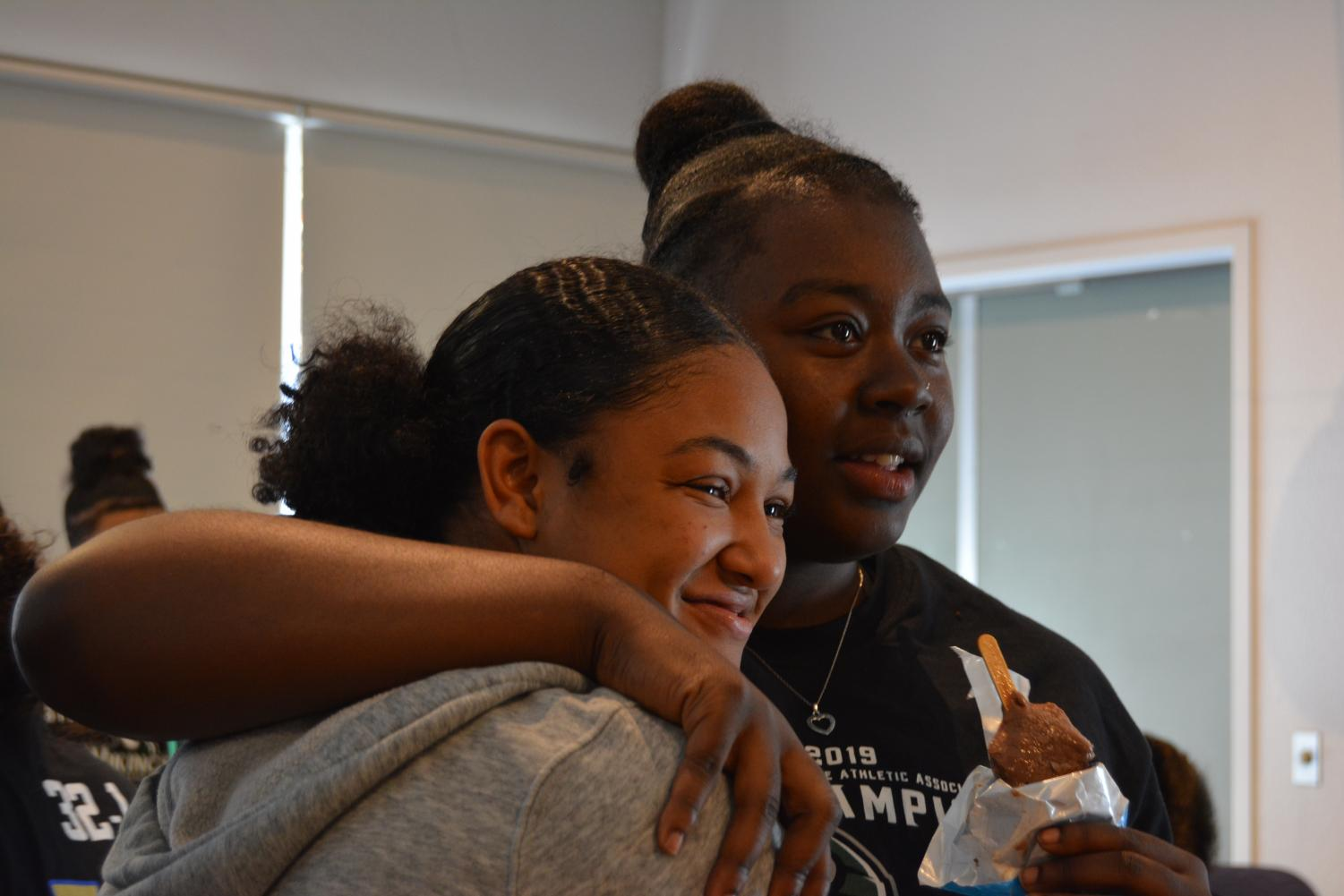 Sierra Smith (left) and Zahria Hendrix (right) celebrate their state championship victory with members of DVC in the Business/Foreign Language building on April 16, 2019. (Samantha Laurey/Inquirer)
