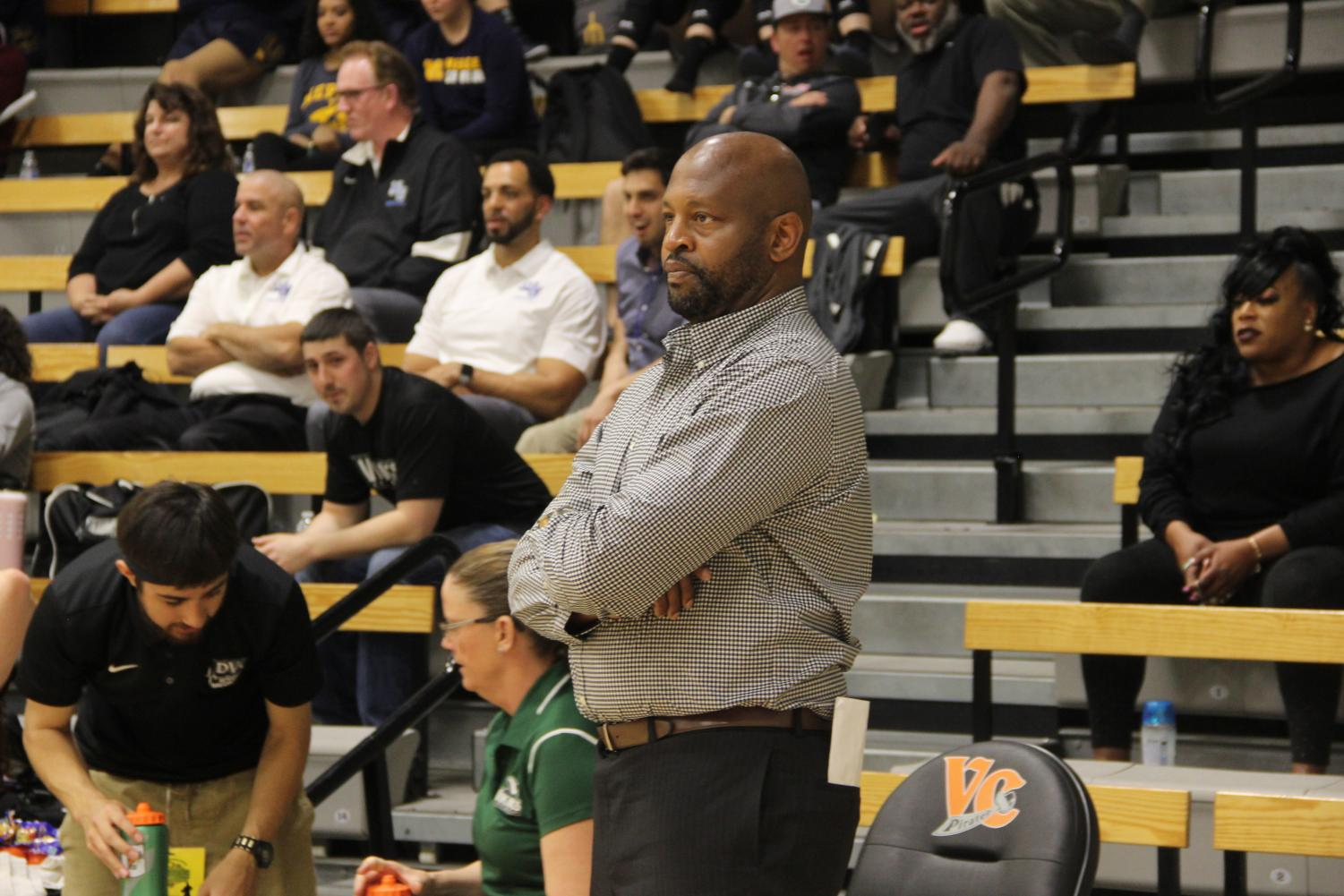 Coach Ramaundo Vaughn diligently watching his players during the Semi-Finals championship. (Alex Martin/The Inquirer).