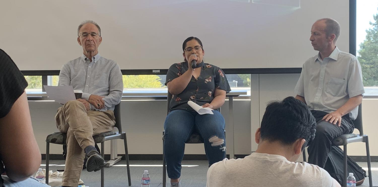Soledad Castillo (center) tells her story about making it to the United States alongside Stephen Mayers (left) and Jonathan Freedman (right) in the Diablo Room on Sept. 25. (Emma Hall/The Inquirer).
