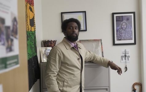 Professor Eric Handy in his counseling office.  (Ethan Anderson/The Inquirer)