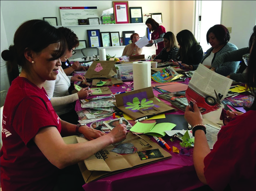 Volunteers of White Pony Express making cards for the holidays. (Photo courtesy of White Pony Express)