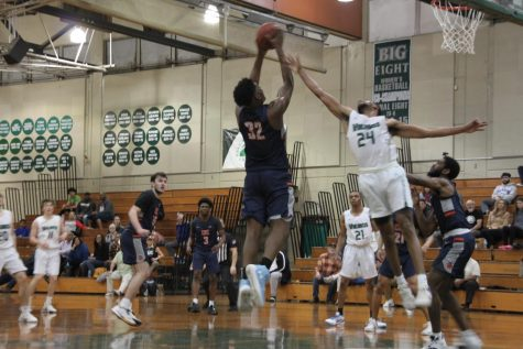 Isaih Hood, power forward, blocks a Cosumnes player (Anthony Perry/The Inquirer).
